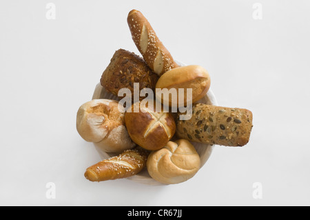 Basket with different kinds of rolls and pretzel varieties, breakfast rolls - Stock Photo