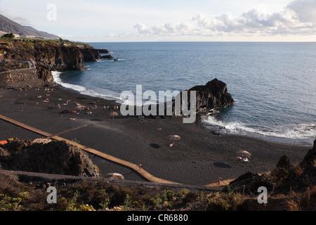 Spain, La Palma, People at Charco Verde Beach - Stock Photo