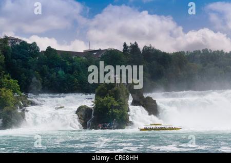 Rhine Falls near Schaffhausen, boat cruising close to the waterfall, Switzerland, Europe - Stock Photo