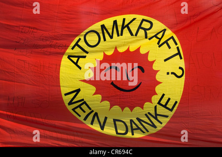 Banner 'Atomkraft? Nein danke' German for 'nuclear power? No thanks', smiling sun, logo of the anti-nuclear movement - Stock Photo