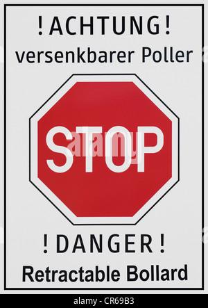 Achtung versenkbarer Poller or Danger, retractable bollard, warning sign - Stock Photo