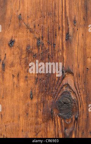 Wood grain with a knot-hole, scratched wooden board, detail, background - Stock Photo