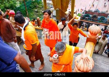 Pilgrims making a milk sacrifice, Hindu festival Thaipusam, Batu Caves limestone caves and temples, Kuala Lumpur, - Stock Photo