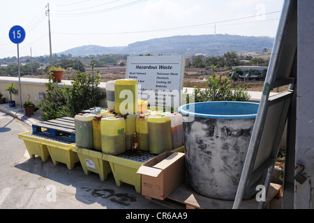 A section in a civic amenity site where hazardous waste is collected. Waste management hierarchy. - Stock Photo
