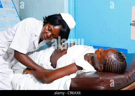 Midwife and pregnant woman, consultation and screening, hospital, Manyemen, Cameroon, Africa - Stock Photo