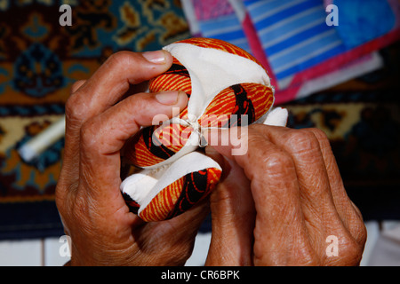 Woman making patchwork, detail hof the ands, artisan, Palalangon, Bandung, Java, Indonesia, Southeast Asia - Stock Photo