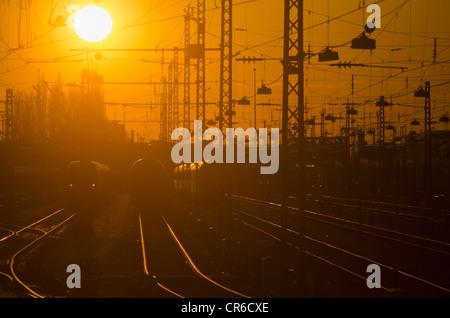 Germany, Bavaria, Munich, View of main station at sunset - Stock Photo