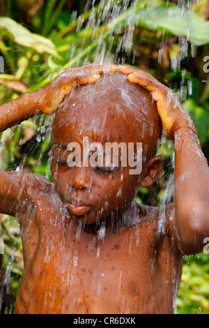 Boy, 6 years, under a shower, Bamenda, Cameroon, Africa - Stock Photo
