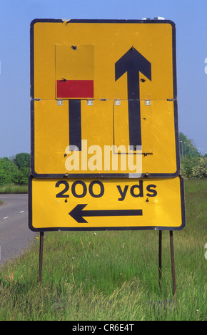 warning sign of closed left hand lane ahead on dual carriageway uk - Stock Photo