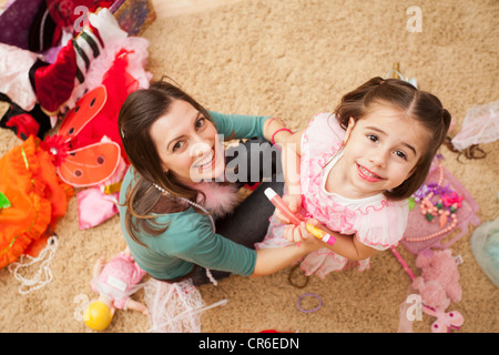 Overhead view of mother with her daughter (4-5) in fancy dress costume - Stock Photo
