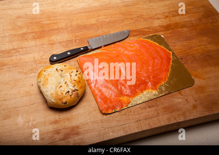 Smoked Salmon with cream cheese on a bagel - Stock Photo