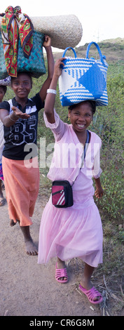 woman carrying basket on head, Fort Dauphin - Berenty road, Madagascar - Stock Photo