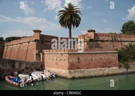 Boats in the canal surrounding the New Fortress, Livorno, Italy - Stock Photo