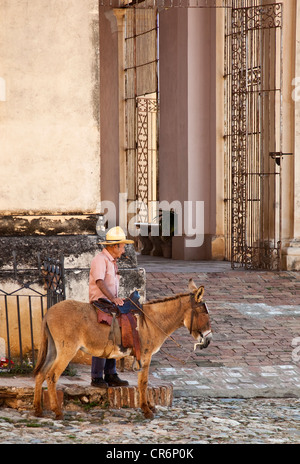 Man on a donkey Trinidad Cuba - Stock Photo