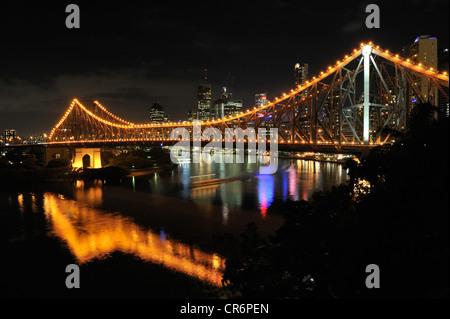 Story Bridge over the Brisbane River at night with cityscape in background. Brisbane, Australia - Stock Photo
