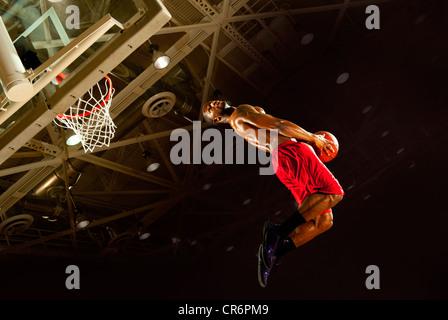 Black man playing basketball - Stock Photo