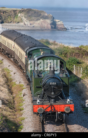 Double header.  Two small GWR prairie class locomotives pulling train from Minehead, approaching Doniford Halt. - Stock Photo