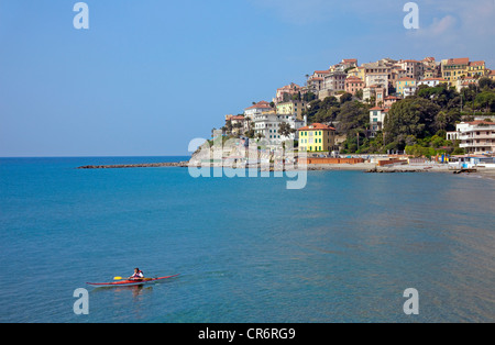 Kayaker in front of Porto Maurizio, , port city on the Ligurian coast, Riviera di Ponente, Liguria, Italy, Mediterranean, Europe