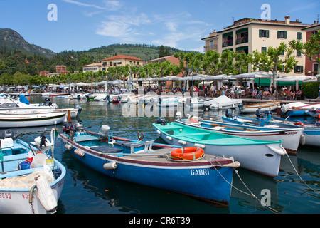Fishing boats on the pier in the port, promenade, Garda, Lake Garda, Verona province, Veneto, Italy, Europe - Stock Photo