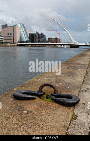 View of the Quay on the Liffey River with the Samuel Beckett Bridge, Dublin Ireland - Stock Photo