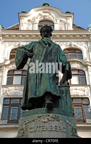 Monument of Johannes Gutenberg, 1400 - 1468, inventor of the printing press, a house built in 1897 at the back, - Stock Photo