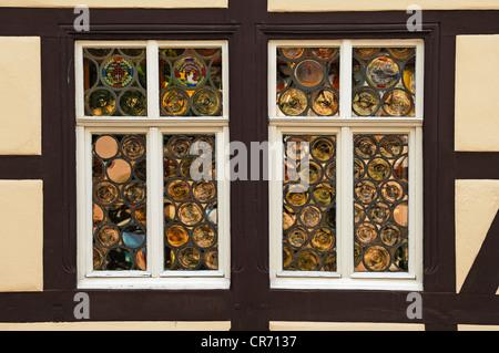 Window with old bull-glass panes on a half-timbered house, Salzmarkt street, Koenigsberg, Lower Franconia, Bavaria - Stock Photo