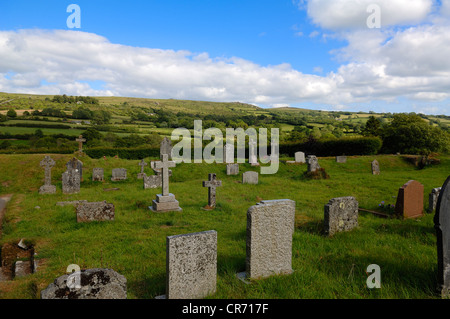 Old cemetery of the church of St. Pancras overlooking the landscape of Dartmoor, Widecombe in the Moor, Dartmoor, - Stock Photo