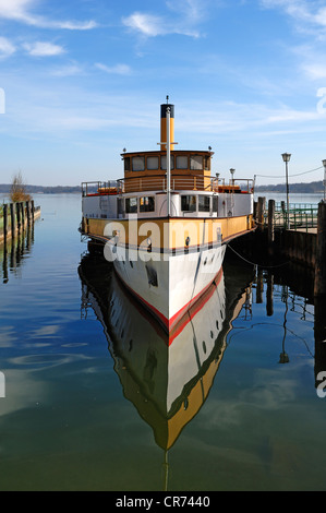 Old paddle steamer 'Ludwig Fessler', built in 1926, anchoring in the harbor of Stock near Prien, Bavaria, Germany, - Stock Photo