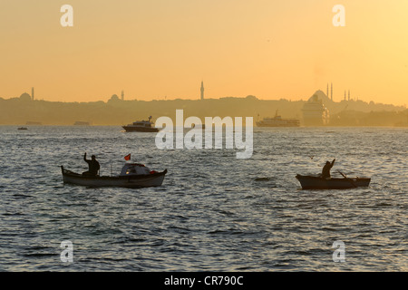 Turkey, Istanbul, fishermen boats on the Bosphorus Strait, the Golden Horn Strait in the background - Stock Photo