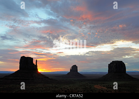The Mitten Buttes at sunrise, Monument Valley, Arizona, USA - Stock Photo