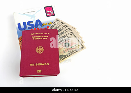 Travel guide to the USA, America, passport of the Federal Republic of Germany, several 50-dollar bills, symbolic - Stock Photo