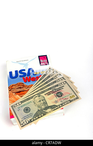 Several 50-dollar bills, travel guide of the USA, America - Stock Photo