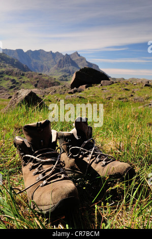 Walking boots airing outside a tent. Wild camping view on the Isle of Skye - Stock Photo