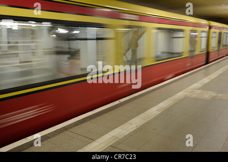 Train entering the Berlin S-Bahn railway station at Potsdamer Platz, Berlin, Germany, Europe - Stock Photo
