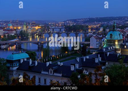 Overlooking Charles Bridge and Vltava River at night, Old Town Square, historic centre, Prague, Bohemia, Czech Republic, - Stock Photo