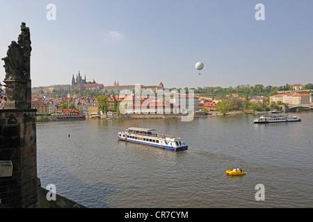 Excursion boats on the Vltava River, Charles Bridge, Prague, Bohemia, Czech Republic, Europe - Stock Photo