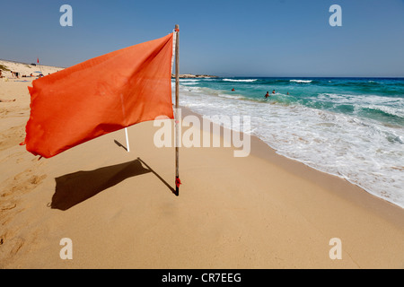 Red warning flag on a beach, bathing is prohibited due to an undercurrent, Fuerteventura, Canary Islands, Spain, - Stock Photo