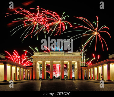 Brandenburg Gate with fireworks display, Berlin, Germany, Europe, composite - Stock Photo