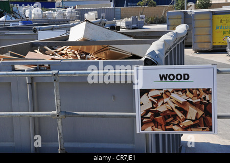 A section in a civic amenity site, sometimes called bring in site, where wood is dumped to be recycled. - Stock Photo