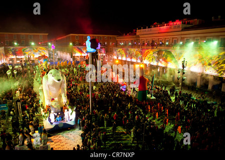 France, Alpes Maritimes, Nice, Old Town, Place Massena, statue by Jaume Plensa, Carnival 2010, the floodlit Corso - Stock Photo