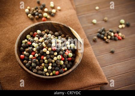 Peppercorns in Wood Bowl - Stock Photo