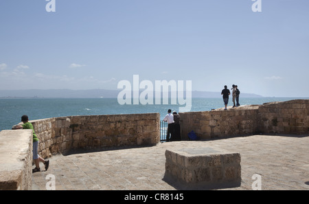 Historic battlement and seawall in the Old City of Acre, Israel - Stock Photo
