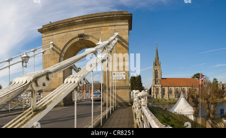 Marlow Suspension Bridge and All Saints Church by Thames river, Marlow, Buckinghamshire, England, United Kingdom, - Stock Photo