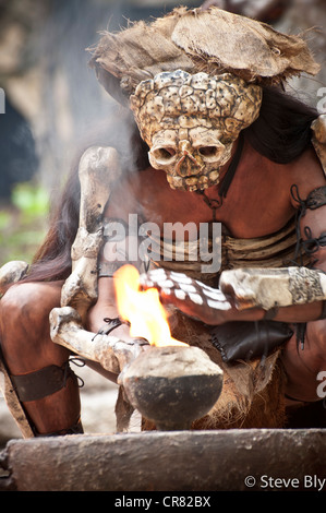 A Maya fokllore fire dance ritual is performed by a mystical performer in Xcaret Show, Playa Del Carmen, Quintana - Stock Photo