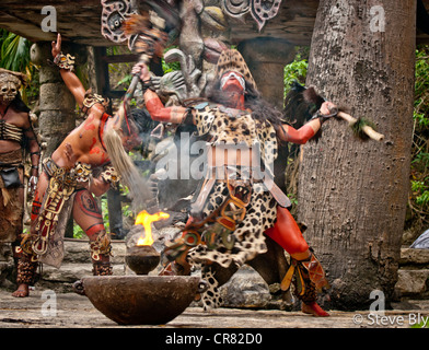 A Maya fokllore fire dance ritual is performed by mystical performers in Xcaret Show, Riviera Maya, Quintana Roo, - Stock Photo