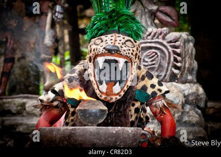A Maya fokllore fire dance ritual is performed by a mystical performer in Xcaret Show, Riviera Maya,, Quintana Roo, - Stock Photo