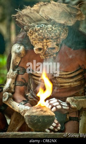 A Mayan fokllore fire ritual is performed by a Maya mystical performer at  Xcaret Park,  Riviera Maya, Mexico - Stock Photo