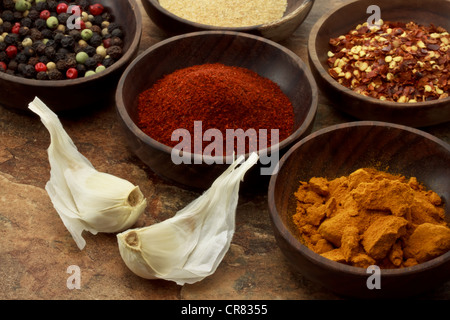 Collection of spices in wooden bowls - Stock Photo