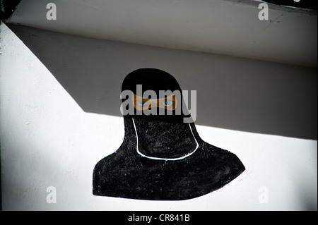 Artistic detail of drawing depicting a Muslim women - Stock Photo