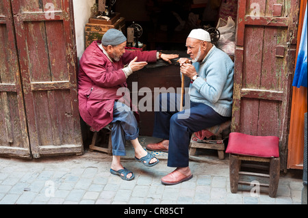 Morocco High Atlas Marrakech imperial city medina listed as World Heritage by UNESCO old Moroccan conversing in - Stock Photo
